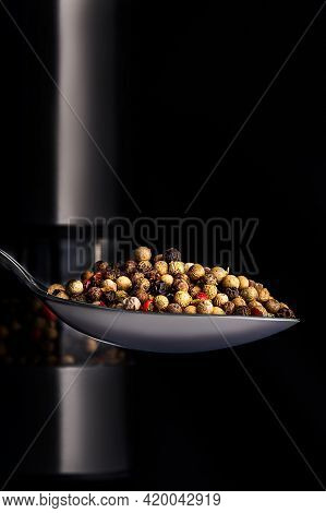 Pepper Peas In A Tablespoon On The Background Of Peppercorns