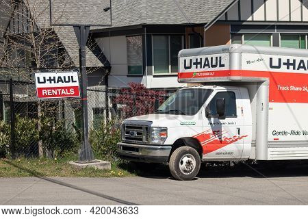 Courtenay, Canada - April 22,2021: Close Up View Of Sign U-haul Rentals With U-haul Truck On 19a Hig