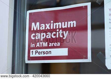 View  Of Sign On The Window Maximum Capacity In Atm Area 1 Person Due To Covid-19