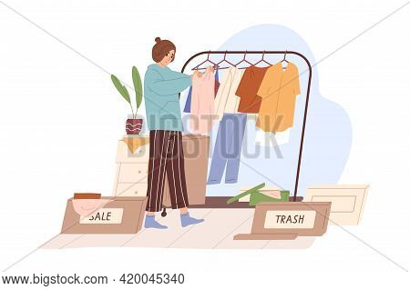 Woman Decluttering And Organizing Wardrobe, Putting Clothes Into Sale And Trash Boxes. Person Taking