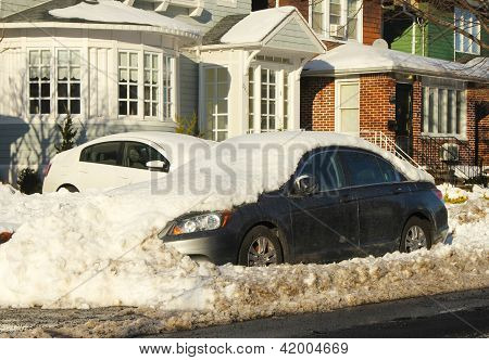 Cars under snow in Brooklyn, NY after massive snowstorm