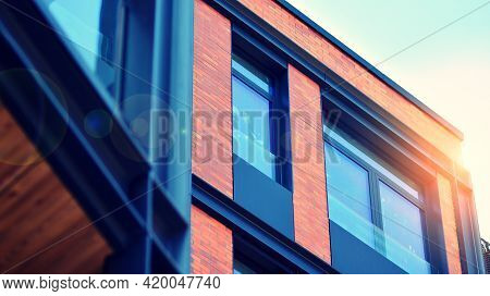 Architectural Exterior Detail Of Residential Apartment Building With Brick Facade. Modern Brick And
