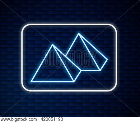 Glowing Neon Line Egypt Pyramids Icon Isolated On Brick Wall Background. Symbol Of Ancient Egypt. Ve