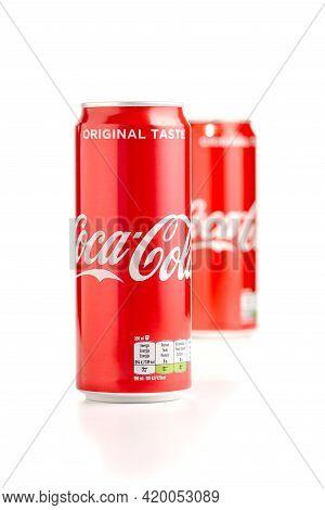 Tallinn, Estonia - 10.05.2021: Closeup Of Two Aluminum Red Can Of Coca-cola. Coca-cola Popular Soda