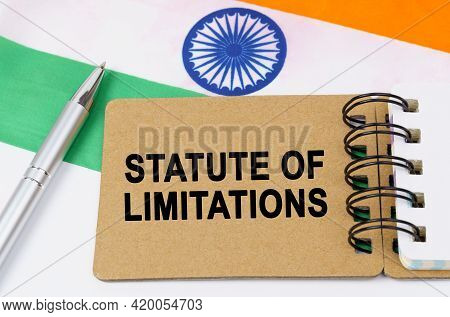 Law And Justice Concept. Against The Background Of The Flag Of India Lies A Notebook With The Inscri