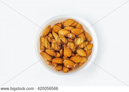 Process Of Soaking Various Nuts: Almonds In Water To Activate. Home Cooking: Making Plant Based Orga
