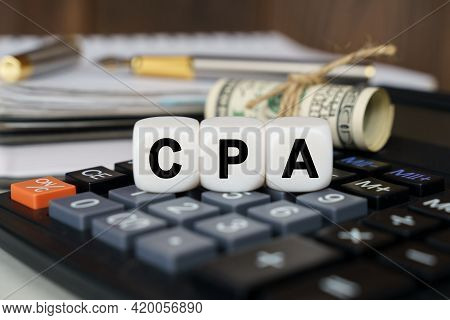 Business And Finance Concept. The Calculator Has Dollars And Cubes That Say - Cpa