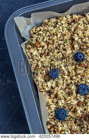 Raw Granola, Muesli From Oat Flakes, Varius Of Nuts, Honey, Pumpkin Seeds On Baking Sheet. Home Cook