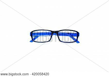 The Blue Eyeglasses On A White Background.