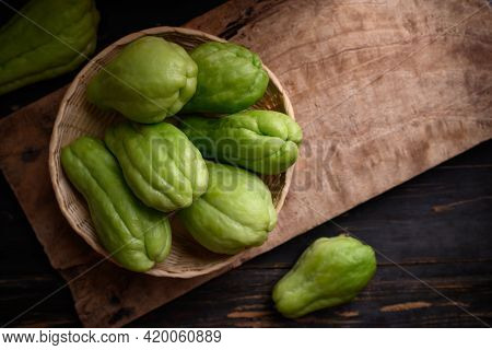 Chayote Squash Fruit (mirliton, Pipinola Or Choko) In A Basket On Wooden Background, Edible Fruit Ea