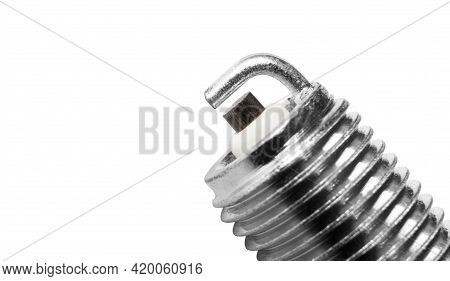 Macro Shot Spark Plug Isolated On White Background. A Spark Plug For An Engine Isolated With Clippin