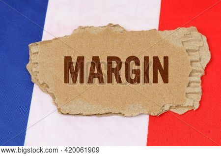 Business And Finance Concept. Against The Background Of The French Flag Lies Cardboard With The Insc