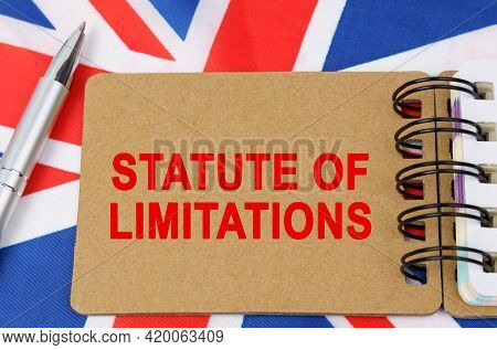 Law And Justice Concept. Against The Background Of The Flag Of Great Britain Lies A Notebook With Th
