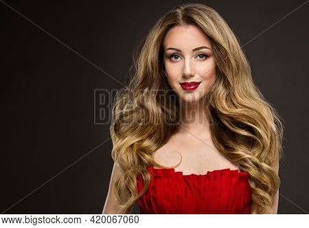 Beauty Woman With Long Wavy Hair. Dark Blonde Girl With Curly Shiny Hairstyle. Fashion Model Red Lip