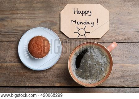Happy Monday Message, Aromatic Coffee And Cupcake On Wooden Table, Flat Lay