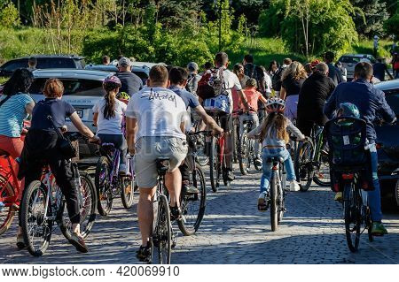Uzhgorod, Ukraine - May 10, 2021: Participants Of A Mass Bike Ride Ride Down The Street During The O