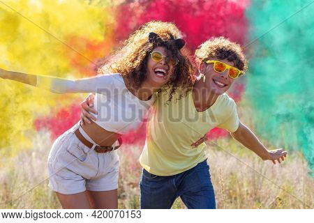 Beautiful Young Man And Woman Surrounded Colored Smoke Bombs Fog - Happy Friends Having Fun In The P
