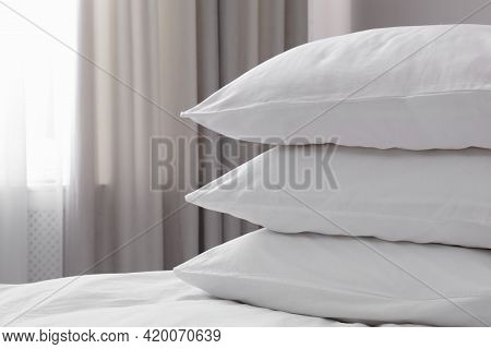 White Soft Pillows On Bed. Space For Text