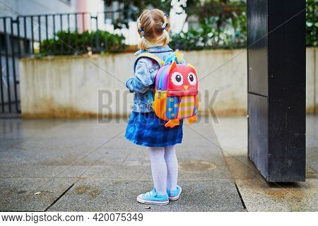Adorable Toddler Girl With Funny Backpack Ready To Go To Daycare, Kindergarten Or School. First Day