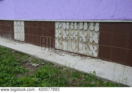 Slipped, Broken, Fallen Off Ceramic Tiles, Missing Wall Tiles On A House Foundation Wall Caused By T