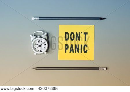 Dont Panic - Text On Sticky Note Paper. Closeup Of A Personal Agenda. Top View. Conceptual Photo