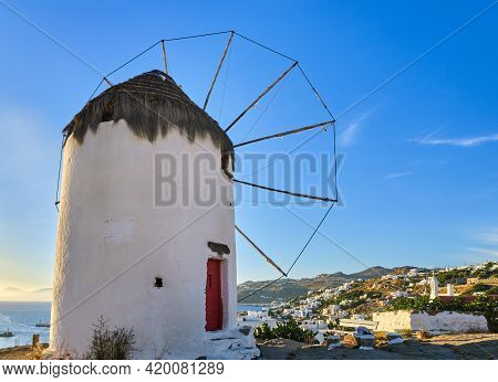 Famous Tourist Attraction Of Mykonos, Greece. Traditional Whitewashed Windmill On Hilltop. Summer, S