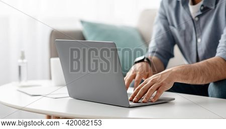 Working At Laptop Pc. Male Hands On Pc Keyboard, Typing Text Or Programming Code In Computer