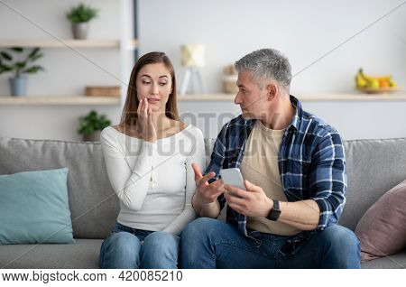 Mature Man Finding Out About His Wifes Affair, Confronting Her About Photos With Lover On Mobile Pho