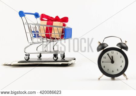 Metal Chrome Shiny Shopping Trolley On Wheels With Gift Box On Wallet With Dollars And Alarm Clock I