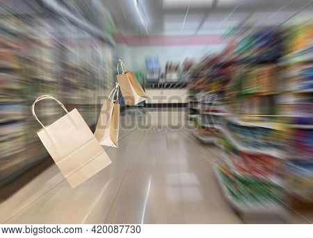 The Supermarket Blurred The Aisle With Shelves And Various Merchandise, With Paper Bags Floating On