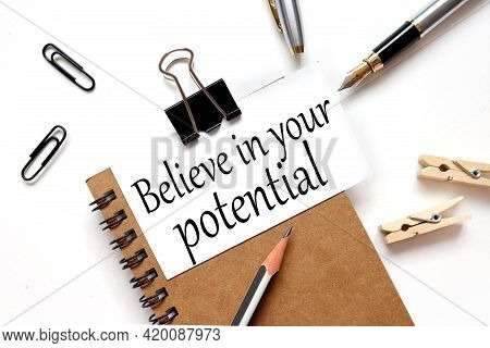 Believe In Your Potential. Motivational Quote. The Inscription On The Business Card Is Attached To T