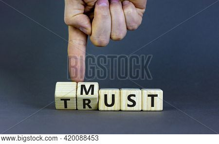 Must Trust Symbol. Businessman Turns Wooden Cubes With Words 'must Trust'. Beautiful Grey Table, Gre