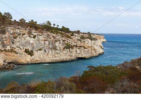 Rocky Seashore. Steep Coast. A Steep Cliff Near The Sea. Porto Cristo, Mallorca. Travel Concept. Hig