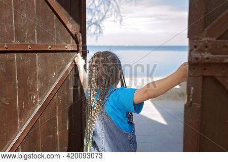 Preteen Happy Girl Opening Wooden Door To Sunny Seaside, Follow Me Shot, Hello Summer Concept, Famil