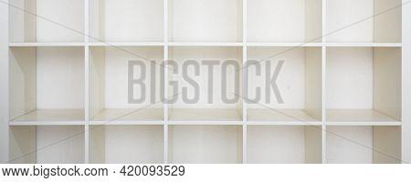 Empty bookshelf. Empty  White shelving