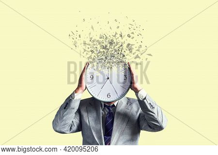 Businessman With A Disintegrating Clock Instead Of A Head. Dispersion Effect. Lack Of Time. Waste Of