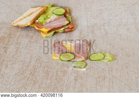 Fallen And Spoiled Sandwich On The Sofa With Dirty Stain.