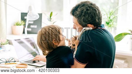 Father Working From Home And Online Education With Kid Son. Stressed With Dog And Phone. Child Make