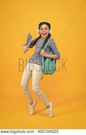 Follow Your Dreams. Happy Child Enjoy Holidays Yellow Background. Little Girl Go From School. School