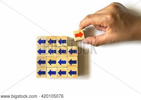 The Hand Is Selecting A Wooden Cube With Red Arrow In Different Direction And Blue Arrow With Differ