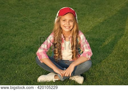Technology Helping To Unwind. Happy Girl Relax On Green Grass. Little Child Listen To Music Outdoors