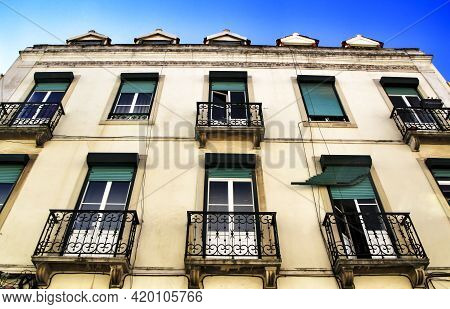 Old Colorful Houses And Streets Of Lisbon, Portugal In Spring. Majestic Facades And Old Street Light