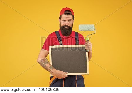 Painting Works. Bearded Man Painter Hold Blackboard. Wall Painter With Painting Tool. Brush Roller P