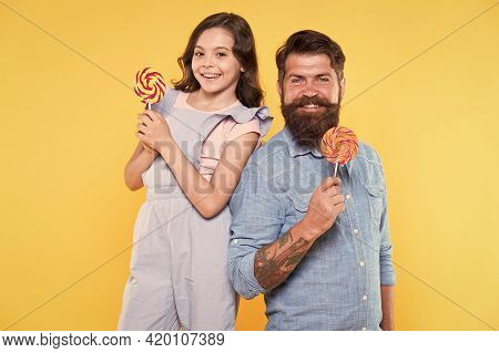 Lollipop A Day Helps You Rest And Play. Happy Family Hold Lollipop Treats Yellow Background. Father