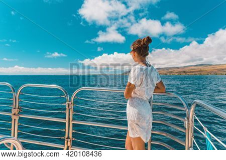 Cruise ship elegant lady in white cover up beach dress relaxing on boat deck watching scenery landscape on Mediterranean sea, Europe summer travel vacation.
