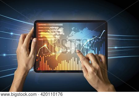 Close-up Of Business Man\'s Hand Holding Tablet Showing Stock Market Statistics Gain Profits And Inc