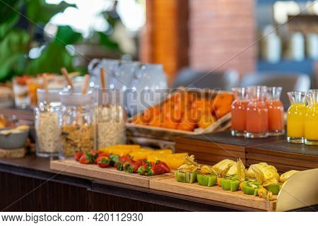 Breakfast Buffet Served With Orange Juice, Croissants Cereal And Strawberry Fruits