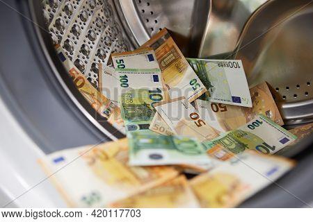 Money In Washing Machine, Closeup. Money Washing And Laundering
