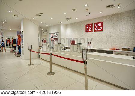 KUALA LUMPUR, MALAYSIA - CIRCA JANUARY, 2020: cash desk at Uniqlo store in Kuala Lumpur.