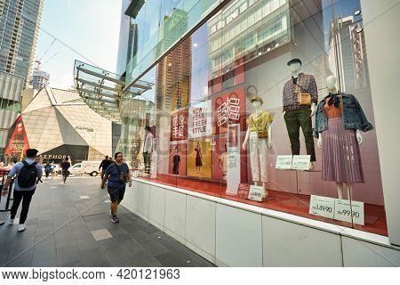 KUALA LUMPUR, MALAYSIA - CIRCA JANUARY, 2020: street level view of Uniqlo display window in Kuala Lumpur in the daytime.